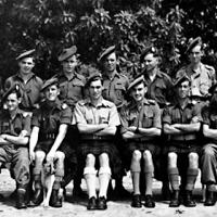Gordon Graham (front row, sitting in centre with pale shirt) and his unit before being despatched to India in 1942